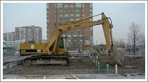 excavator begins digging at sewells road construction site