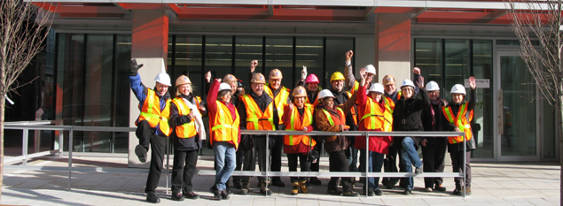 Wigwamen staff and Board members pose in front of the Pan Am / Parapan Am Building