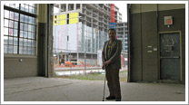 President Bill Kinoshameg with Pan Am / Parapan Am building under construction in background